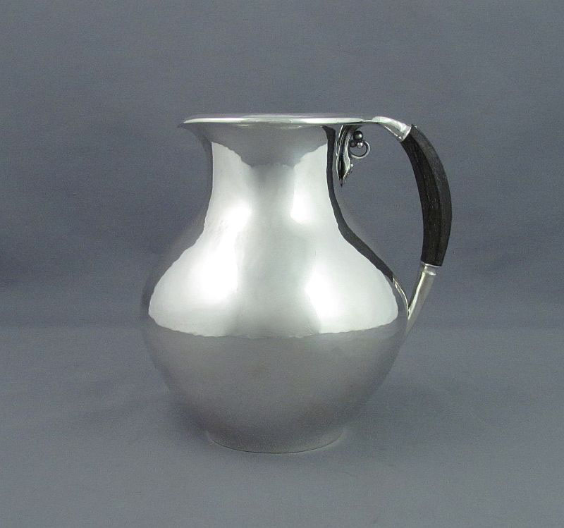 A Georg Jensen silver jug designed by Jorgen Jensen in 1923, model number 385B, Copenhagen 1925-30. Flared rim