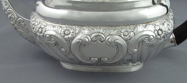 A fine quality Edwardian sterling silver tea service by Henry Wigfull, hallmarked Sheffield 1901. The set includes a teapot