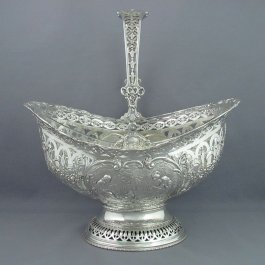 silver cleaning tips for A large German .800 silver flower basket, Hanau c. 1900. Pierced oval body with swing handle on pedestal base, embossed