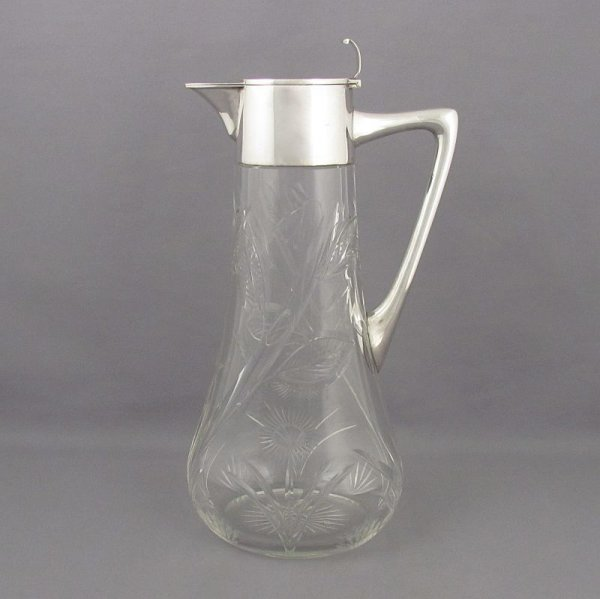 An Art Nouveau silver claret jug c. 1910, Austro-Hungarian c. 1910. .800 silver collar, lid and handle, with tapered oval