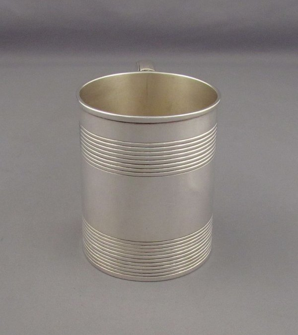 A George III silver mug probably by Robert Gaze hallmarked London 1815. Tapered cylindrical shape with two bands of reeded