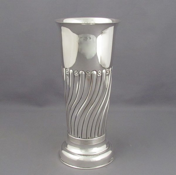 An Edwardian sterling silver vase, maker's mark is rubbed ?A, hallmarked Birmingham 1901. Cylindrical shaped body embossed