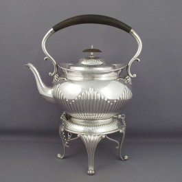 A Victorian sterling silver kettle on stand by Elkington & Co, hallmarked for Birmingham 1892. Half fluted oval body with