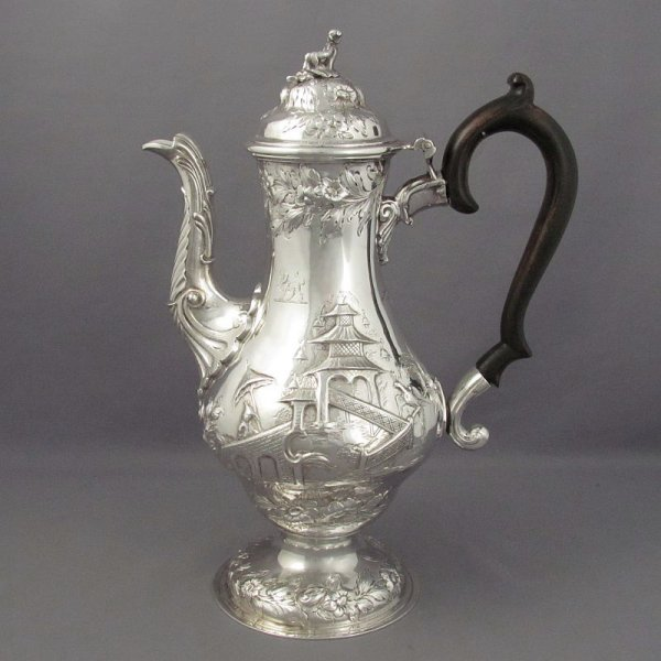 A George III Chinoiserie silver coffee pot by unregistered maker's mark IB over WB (Grimwade #3626), hallmarked London 1764. Baluster