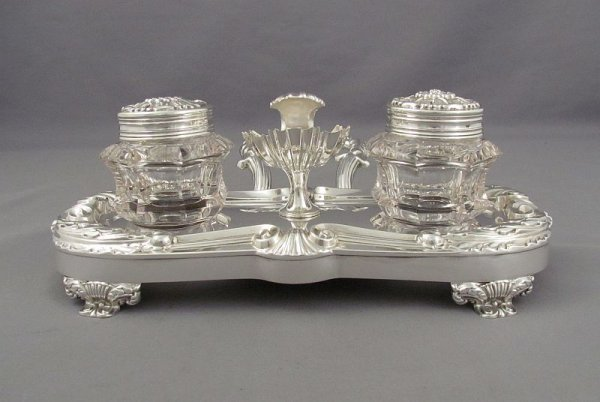 A Dutch sterling silver inkstand hallmarked for Amsterdam 1857 (.934 standard silver). Oblong shape with embossed scroll acanthus