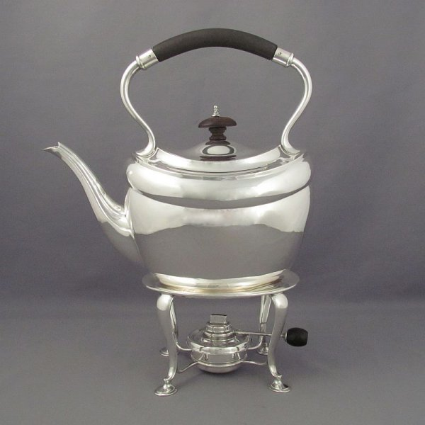 An antique George V sterling silver kettle on stand by Henry Atkins, hallmarked for Sheffield 1921. Oval body with scroll spout, on a stand