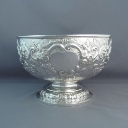 A late Victorian sterling silver rose bowl by George Lambert, hallmarked London 1899.  Hemispherical shape on pedestal foot with repoussé scrolls