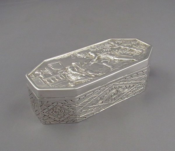 A Victorian sterling silver jewellery box by Robert Humphries, hallmarked London 1898. Rectangular with canted corners, the lid