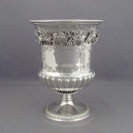 A large George IV sterling silver cup or vase by William Eaton, hallmarked London 1823. Campana shaped, decorated with a band of cast