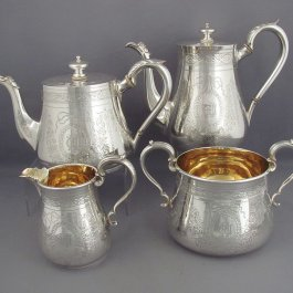 A four-piece Victorian sterling silver tea service by Charles Frederick Hancock, hallmarked for London 1865. The set comprising a coffee pot, teapot, cream jug and sugar bowl.