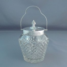 An Edwardian sterling silver jam jar by William Hutton & Sons, hallmarked Birmingham 1903. Fine quality hand cut glass body fitted with